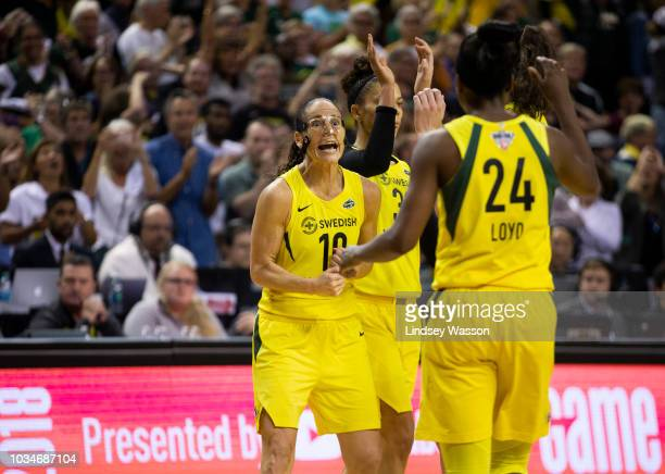 Sue Bird of the Seattle Storm yells as Jewell Loyd comes over to greet her after they gained possession with a slim lead over the Mystics late in the...