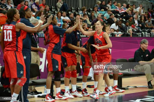 Sue Bird of the United States high fives her teammates against Angola at the Olympic Park Basketball Arena during the London Olympic Games on July 30...