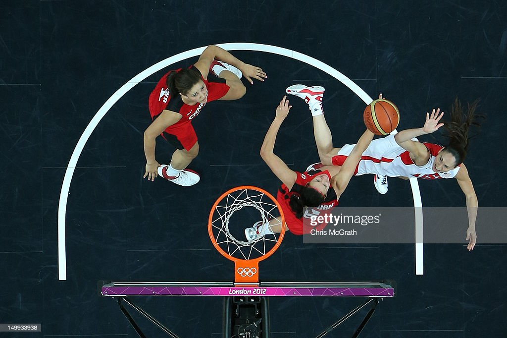 Sue Bird #6 of the United States shoots over Shona Thorburn #6 of Canada during the Women's Basketball quaterfinal on Day 11 of the London 2012 Olympic Games at the Basketball Arena on August 7, 2012 in London, England.