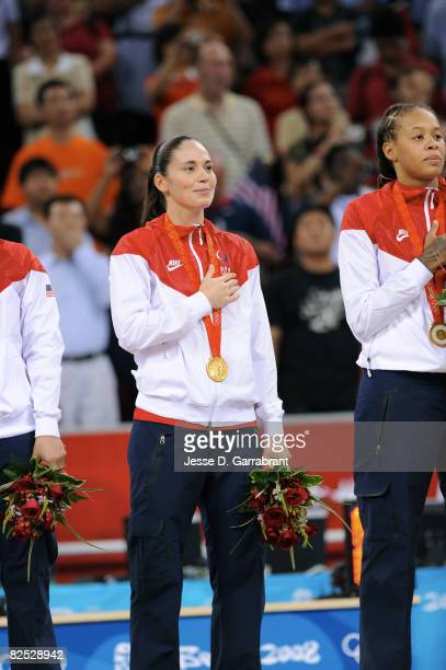 Sue Bird of the U.S. Women's Senior National Team celebrates on the podium after winning the gold medal against Australia at the Beijing Olympic...