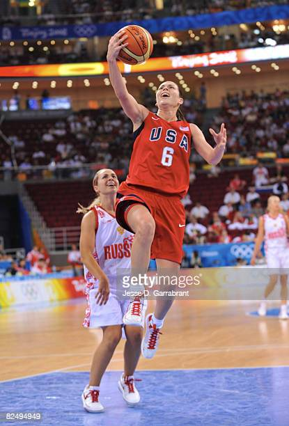 Sue Bird of the U.S. Women's Senior National Team shoots against Becky Hammon of Russia during the women's semifinals basketball game at the 2008...