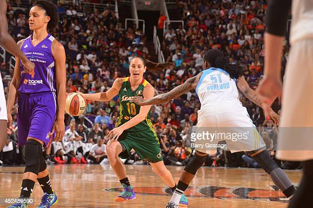Sue Bird of the Western Conference AllStar dribbles against Jessica Breland of the Eastern Conference AllStars during the 2014 Boost Mobile WNBA...