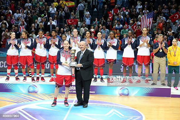 Sue Bird of the Women's Senior US National Team receives the Championship Trophy after defeating Spain during the finals of the 2014 FIBA World...