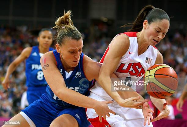 Sue Bird of United States and Marion Laborde of France battle for the ball in the second quarter during the Women's Basketball Gold Medal game on Day...