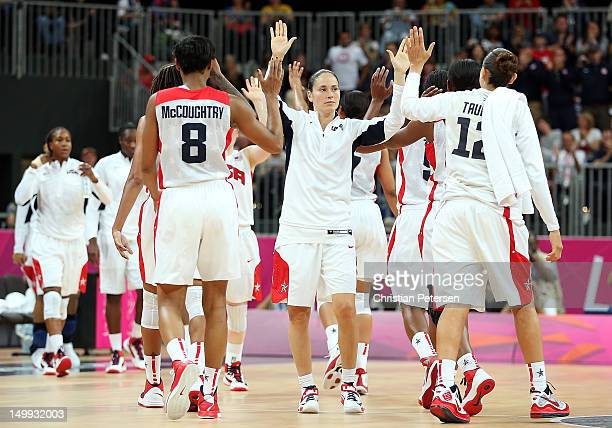 Sue Bird of United States highfives Angel McCaughtry and Diana Taurasi after defeating Canada 91 48 in the Women's Basketball quaterfinal on Day 11...