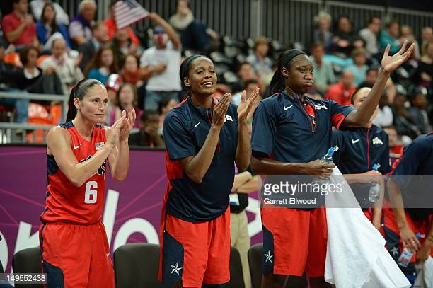 Sue Bird Swin Cash and Sylvia Fowles applaud against Angola at the Olympic Park Basketball Arena during the London Olympic Games on July 30 2012 in...
