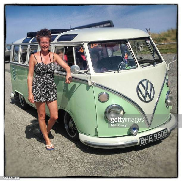 Sue Bunclark from Rotherham poses for a photograph besides her 1964 first generation or T1 splitscreen Volkswagen Transporter Samba van in Newquay on...