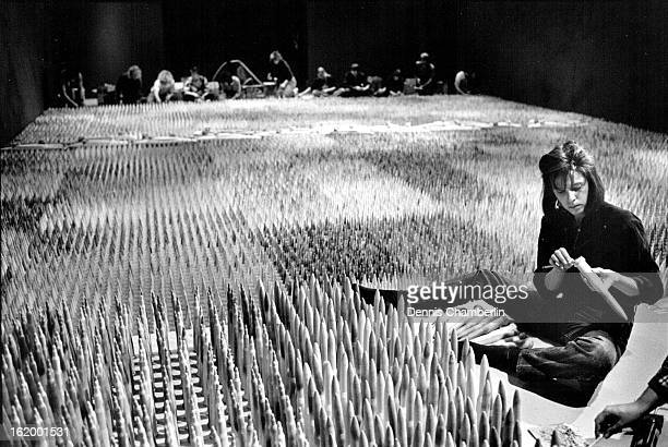 FEB 4 1987 Sue Daniel was one of the almost 6 0 people who helped set up 'Amber Waves of Grain' at the Hatton Gallery on Monday and Tuesday The work...