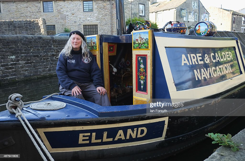 Sue Day stands on her narrowboat Elland take part in the Skipton Waterway Festival on May 3, 2014 in Skipton, England. The Waterway festival is a three day annual canal boat event held on the Leeds and Liverpool canal. The event brings together boaters and the local community who take part in the festival activities.