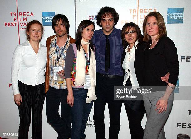 Sue Devine Ivy Band members Andy Chase Dominique Durand Adam Schlesinger Loretta Munoz and Annie Leahy pose for photographs at the Tribeca Film...