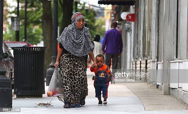 Sue Ege of Lewiston who said she is Americanborn walks on Lisbon Street with her 1yearold son Amir Ibrahim on Tuesday August 16 2016 Somali and other...