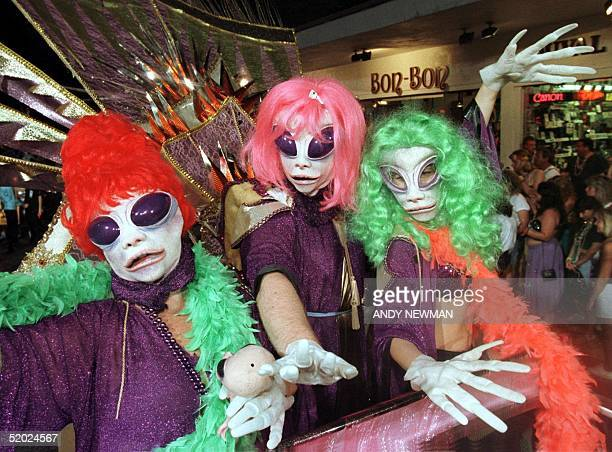 Sue Ellen Spencer Tom Oosterhoudt and Claire Lucas all of Key West FL ride in the Fantasy Fest parade as The Alien Supremes from the X Files late 25...