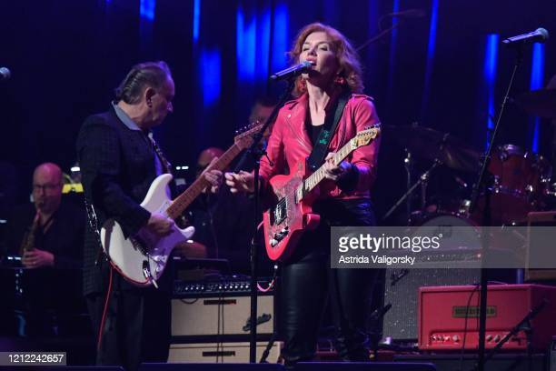 Sue Foley and Jimmie Vaughan perform on stage during the Fourth Annual LOVE ROCKS NYC benefit concert for God's Love We Deliver at Beacon Theatre on...
