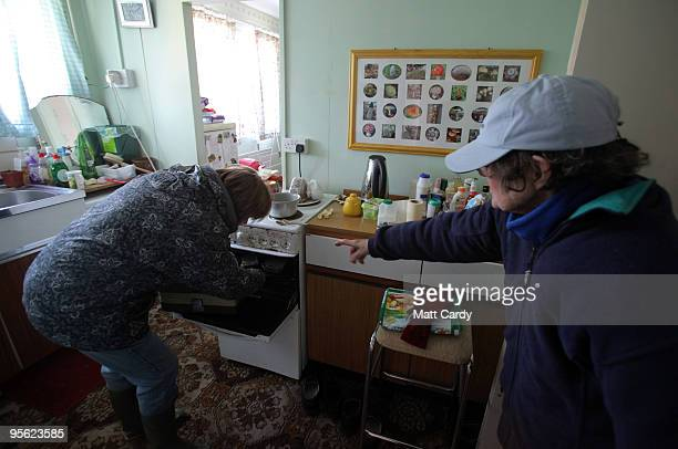 Sue Gardiner manages to deliver meals-on-wheels to elderly residents of High Littleton on January 7, 2010 in Somerset, England. Because of the...