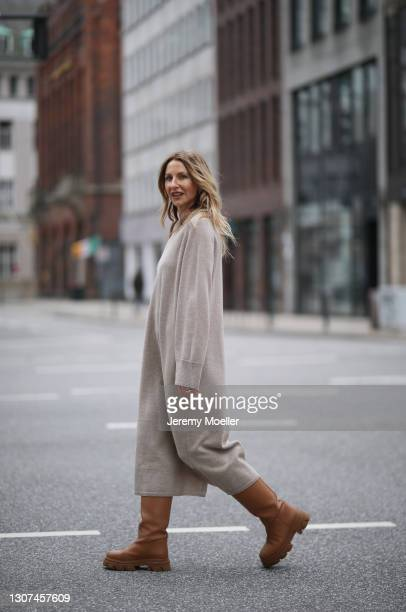 Sue Giers wearing beige SoSUE oversized midi dress and brown Gia Couture Firenze boots on March 07, 2021 in Hamburg, Germany.