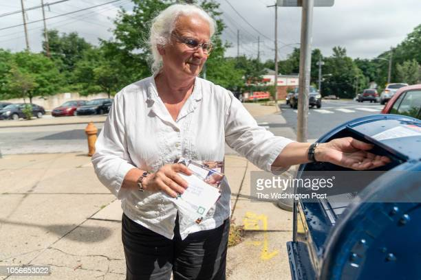 Sue Heckrotte a member of a group of women who gather every week in each others homes to write postcards in the Mt Airy neighborhood of Philadelphia...