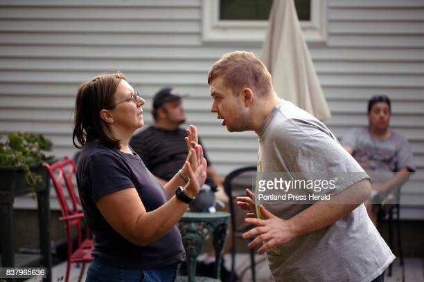 Sue Landreth tries to calm down her son Ethan Poulin during his weekly visit to her home in Manchester Poulin has autism spectrum disorder and...