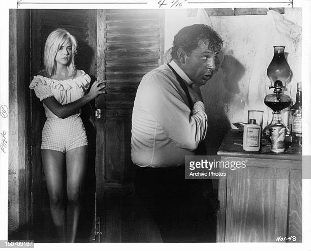 Sue Lyon pays a visit to Richard Burton's room in a scene from the film 'The Night Of The Iguana' 1964