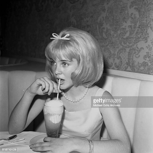 Sue Lyon sips a milkshake after the movie premiere of Lolita at sandpipers in Los AngelesCA