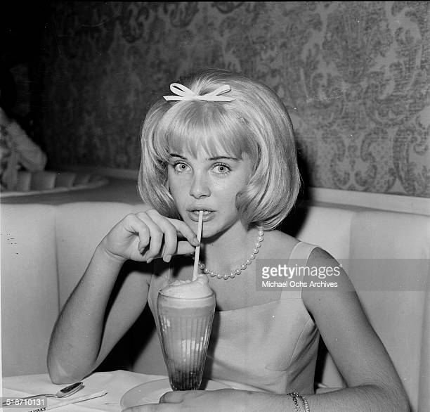 Sue Lyon sips a milkshake after the movie premiere of Lolita at sandpipers in Los AngelesCA