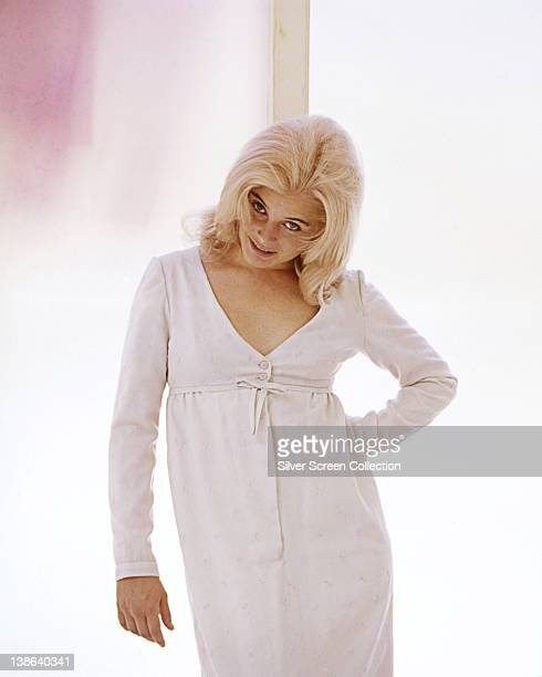 Sue Lyon US actress wearing a white dress in a studio portrait against a white background circa 1965