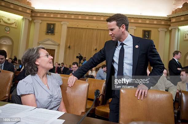 Sue Martinek of the Coalition for Life of Iowa talks with Rep Aaron Schock RIll before a House Ways and Means Committee hearing in Longworth Building...