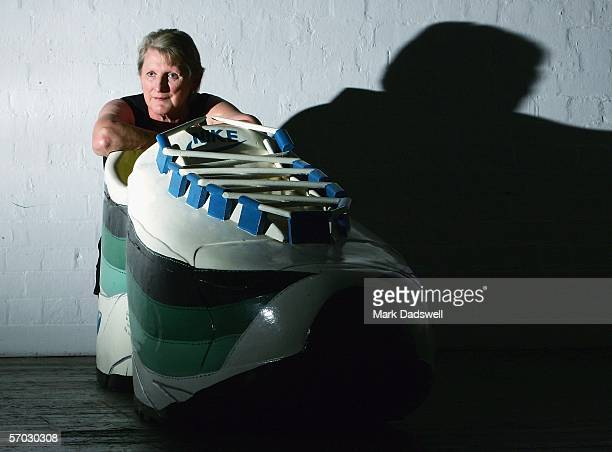 Sue Nattrass Chairman at Exhibitions for Festival Melbourne 2006 studies a Fantasy Coffin in the shape of a running shoe at 45 Downstairs March 9...
