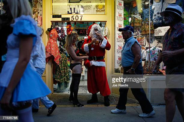 Sue Nelson and Anthony Nelson dressed as Santa Claus participate in the Fantasy Fest Masquerade March October 27 2007 in Key West Florida The 10day...