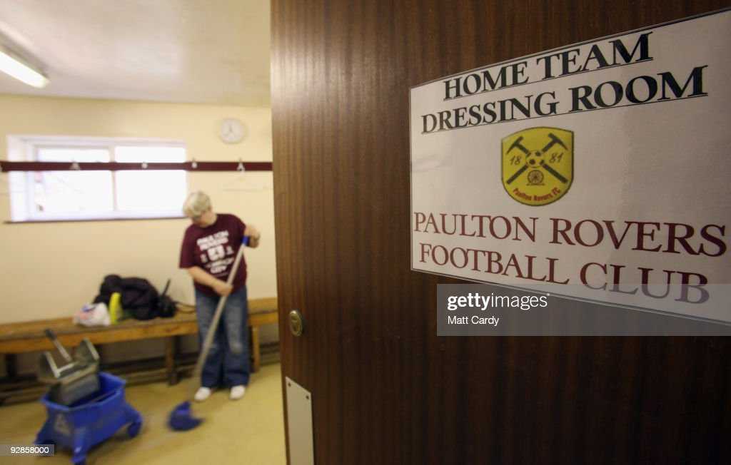 Sue Parsons, cleans the home team's changing rooms at Paulton Rovers Football Club on November 6, 2009 in Paulton, England. Non-league Paulton Rovers are currently preparing for the single biggest day in their 128-year history as they face Norwich City in the FA Cup first round tomorrow. The Somerset village club, which beat Chippenham Town before being drawn against the League One club, normally has an attendance of 200, but will see capacity at the ground swell to 2500 and the match broadcasted live on television to an estimated audience of 2 million.