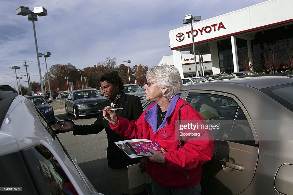 Sue Smith, Right, Looks At The Price Of A Toyota Vehicle At