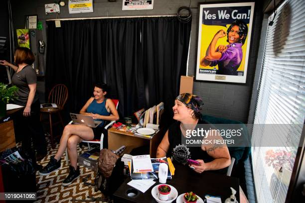 Sue Sweeney shop forewoman at the Girls Auto Clinic takes a break with her team at their garage in Upper Darby Pennsylvania on August 7 2018 On the...