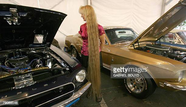 Sue Welsh of Spokane Whashington inspects her 1968 Shelby GT 500KR that she hopes to sell during the 37th Annual BarrettJackson Collector Cars...