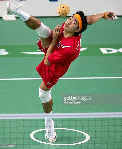 Suebsak Phunsueb of Thailand serves the ball to Malaysia in Sepaktakraw Men's Team Final match during the 15th Asian Games Doha 2006 at Al Sadd on...