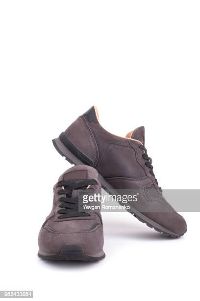 suede sneakers isolated on white background - suede shoe stock pictures, royalty-free photos & images