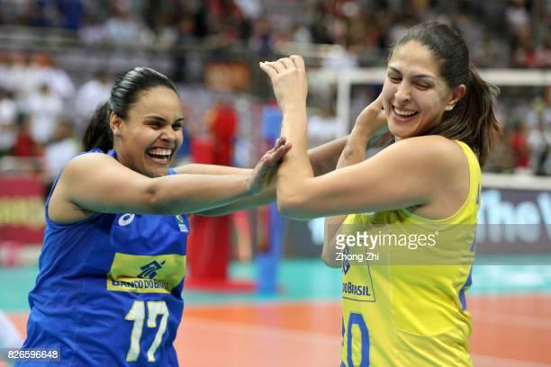 Suelen Pint and Ana Beatriz Correa of Brazil celebrate winning the semi final match between Brazil and Serbia during 2017 Nanjing FIVB World Grand...
