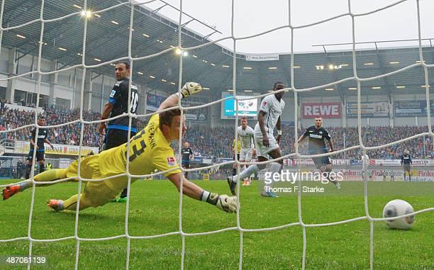 Sueleyman Koc of Paderborn scores his teams first goal against Manuel Riemann of Sandhausen during the Second Bundesliga match between SC Paderborn...