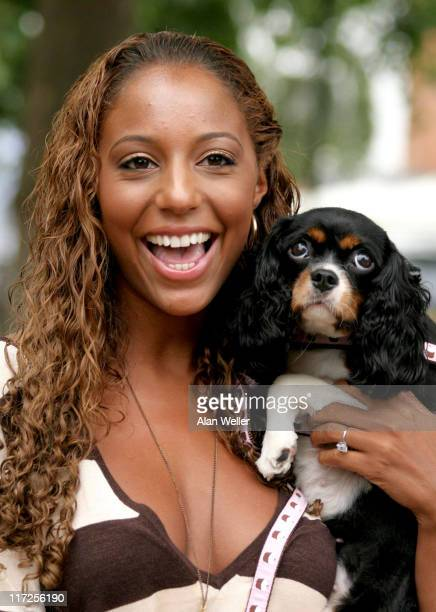 SuElise Nash from Misteeq with her dog Giselle during Pugs and Kisses Celebrity Dog Fashion Show at Parson's Green in London Great Britain