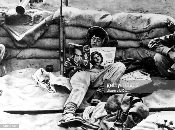Suez Crisis / 2 near east war from 29Oct 56 on Israeli soldier reading a magazine in his sand bag protected position Nov 1956