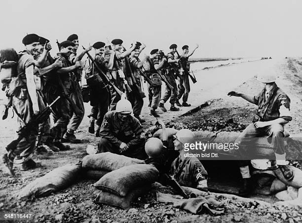 Suez Crisis A Danish contingent members of the UN troops digging themselves foxholes at the Suez Canal they are being waved at by departing British...