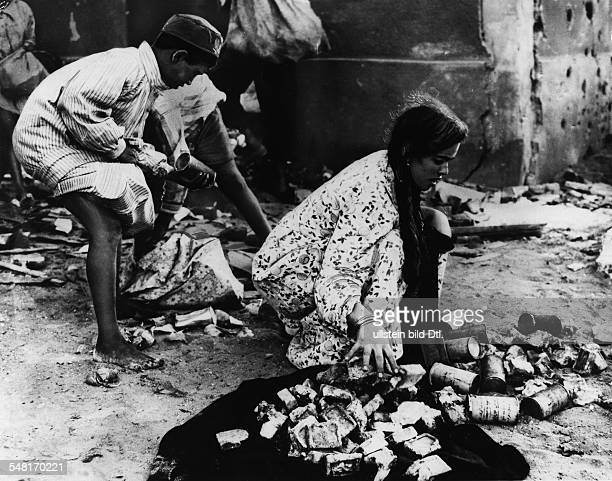 Suez Crisis Anglo - French intervention in the Suez area hungry children searching rubbish for something to eat