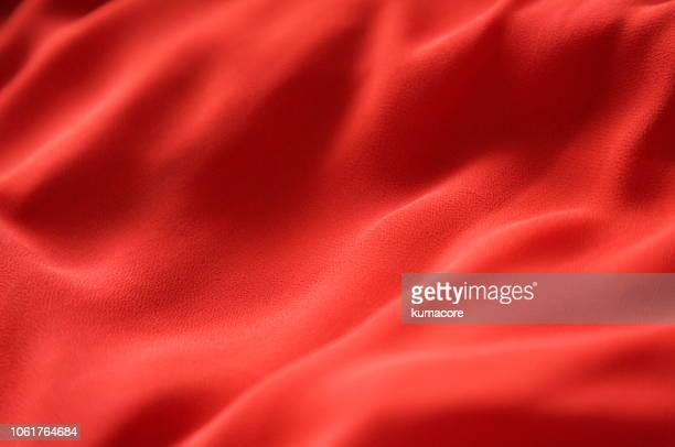 suface of red color cloth - textile stock pictures, royalty-free photos & images