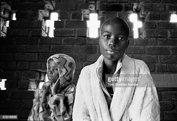AIDS sufferers Loveness Zumara and Laureen Ioga in the chapel of the Mashambanzou Care Trust Harare Zimbabwe It is estimated that 254 million people...