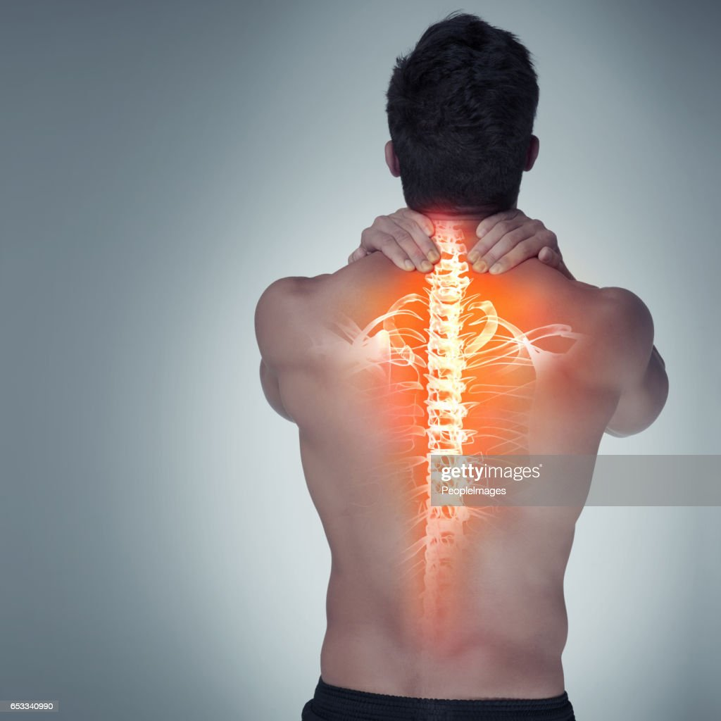 Suffering from tight and tense back pain : Stock Photo