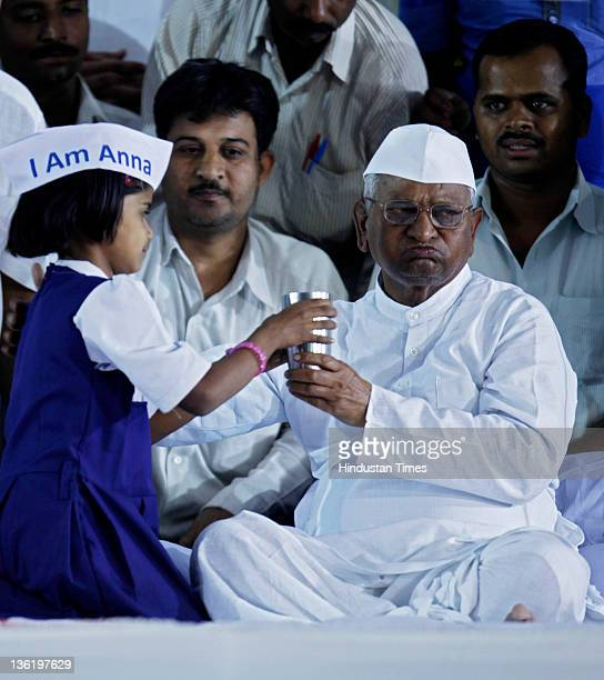 Suffering from viral fever Anna Hazare breaks his fast with a glass of juice offered by a girl on the 2nd day of his 3day Hunger Strike at MMRDA...