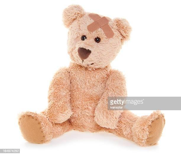 Souffrance blessés joli ours en peluche avec Bandage