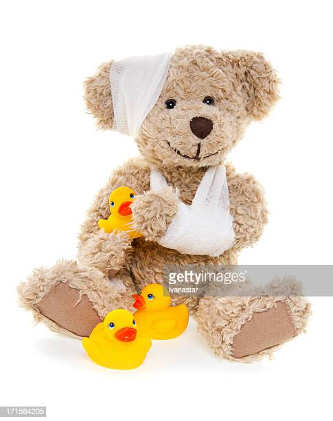 Suffering Injured Sweet Teddy Bear with Rubber Ducks