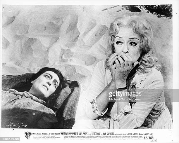 A suffering Joan Crawford at the beach with Bette Davis in a scene from the film 'What Ever Happened To Baby Jane' 1962