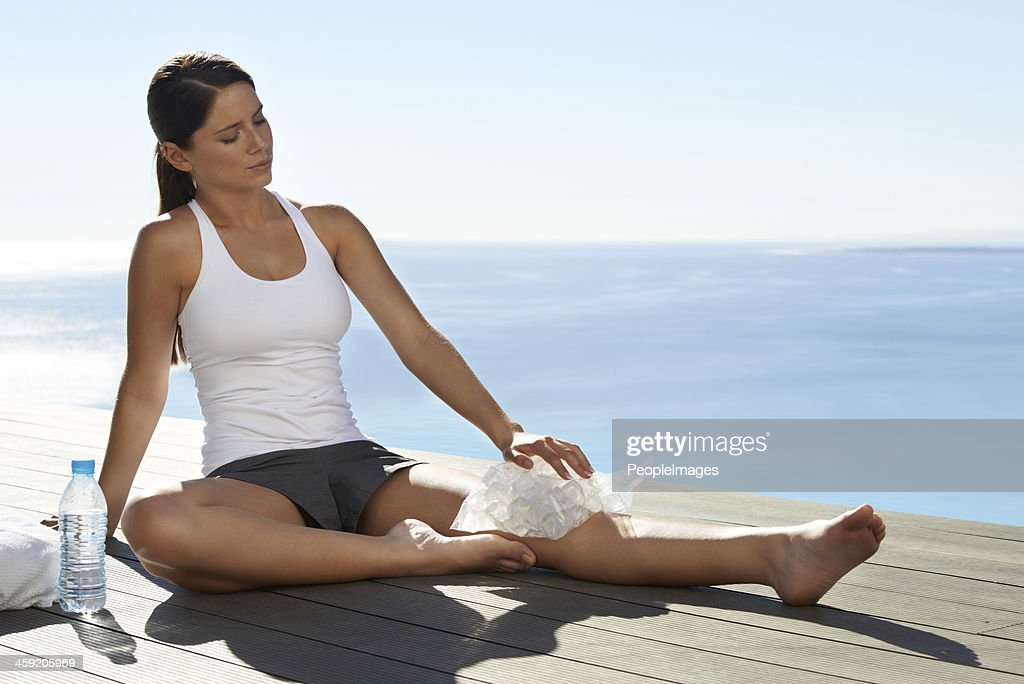 Suffering through a sports injury : Stock Photo