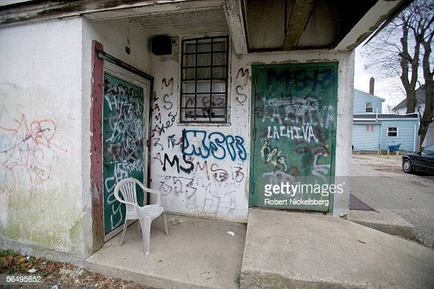 Suffolk County Police from the anti-gang unit keep track of graffiti painted by MS-13, a violent Central American street gang December 1, 2005 in...