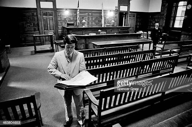 Suffolk Law School student in empty courtroom Somerville Massachusetts 1979